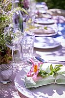 Table setting with fresh flowers and fabric napkins