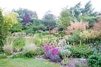 Colourful flowering perennial borders at  Bluebell Cottage Gardens, Cheshire, UK