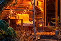 Garden room decorated with fairy lights in December