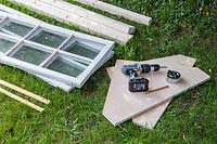 Tools and equipment gathered to make a wooden coldframe