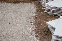 Foundation of compressed crushed concrete for patio.