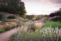 Double herbaceous borders in the walled garden are full of grasses and late season herbaceous perennials that flower long into autumn.