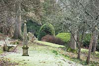Stone obelisk on the terrace through the sloping orchard at the Old Rectory, Netherbury, UK.