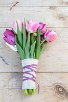 Spring floral bouquet of mixed Tulips with hessian and matching ribbon