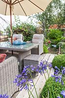 Seating area with lounge garden furniture and parasol