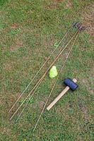 Tools for marking out firepit area including steel fencing pins, string and hammer