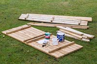 Picnic table kit including tools, paints and sandpaper