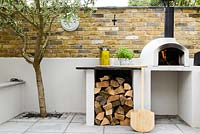 Pizza oven with built in worksurface and wood storage