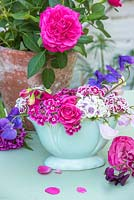 Dianthus barbartus - Sweet williams, roses and sweet peas in vintage blue vase