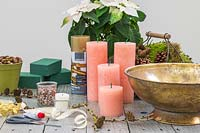 Materials and tools for creating an an indoor arrangement with houseplant and candles