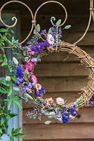 Dried flower wreath - blue and pink hanging on decorative metal frame