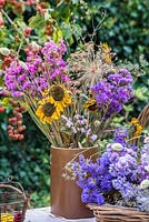 Dried flowers - Sunflowers, Alliums and Statice arranged in earthernware jar