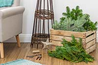 Materials and tools required to construct a space saving Christmas tree in modern living room