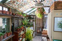 Old fashioned garden room, or potting shed, filled with vintage gardening equipment and paraphanalia