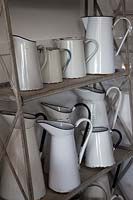 Collection of enamel jugs in the flower arranging studio