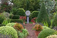 Modern sculpture by Wendy Lawrence in formal country garden