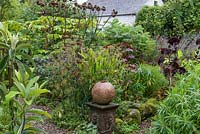 A sculpture by Rosemarie Barr in informal country garden border