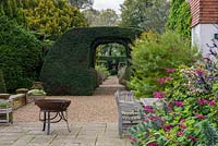 Terrace with view through a monumental yew arch