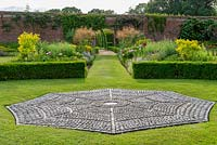 Pebble mosaic in the form of a spider's web. Spider Garden, Hoveton Hall