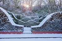 Snow-covered wave-form hedge of Taxus baccata in the Hedge Gardens.