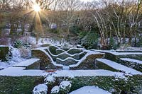 View over the snow-covered Hedge Gardens and coppice.  Garden – Veddw