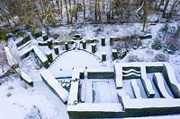 Drone overhead view of snow covered formal garden.  Garden – Veddw