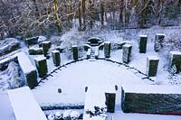 Overhead view of formal country garden covered in snow. Garden – Veddw