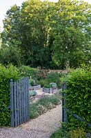 Gate in to the raised bed area with cut flowers and vegetables