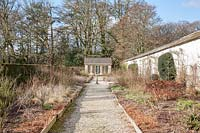 Walled Rose Garden in midwinter, with view to Orangery.