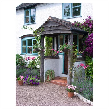 Gap photos garden plant picture library front porch for Front porch hanging plants