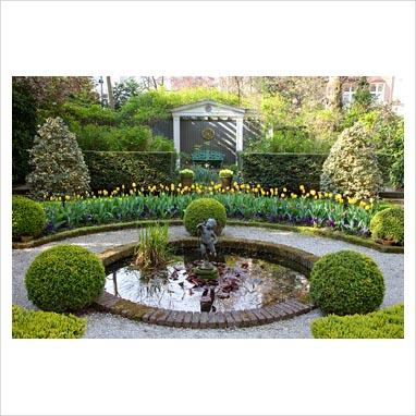 Gap photos garden plant picture library formal for Circular garden ponds